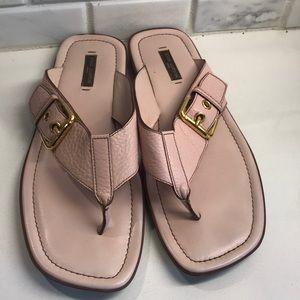 Louis Vuitton leather flip flops.